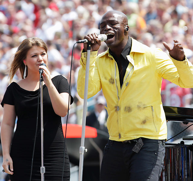 Kelly Clarkson and Seal sing the national anthem.
