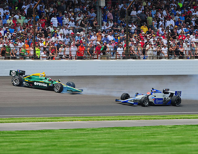 E.J. Viso (59) crashes after contact with James Hinchcliffe (06) during the 95th