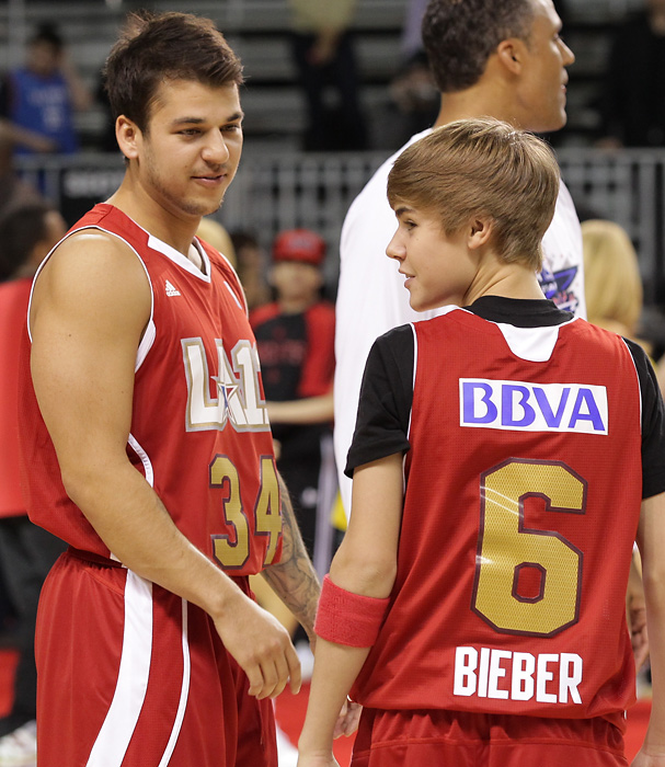 Robert Kardashian and Justin Bieber play at the 2011 BBVA NBA All-Star Celebrity Game in Los Angeles.