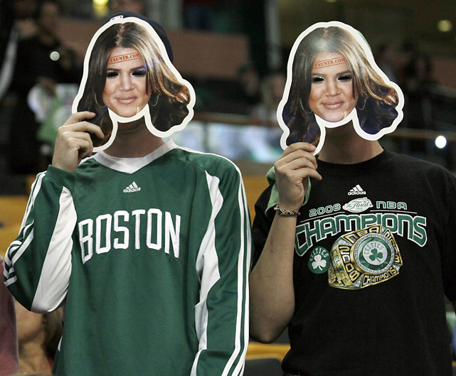 Boston fans taunt Lamar Odom by wearing masks of his wife, Khloe Kardashian, during Game 3 of the NBA Finals.