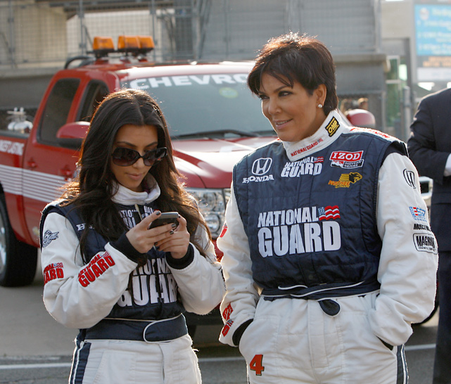 Kim checks her blackberry after joining Kris for a couple of laps during the IZOD Two-Seat Ride Along session at the Indianapolis Motor Speedway.
