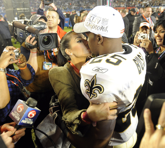 New Orleans running back Reggie Bush gets a kiss from Kim after the Saints defeated the Colts 31-17 in Super Bowl XLIV in Miami.