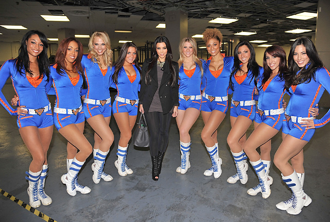 Kim poses with the Knicks City Dancers before a Houston-New York game at Madison Square Garden.