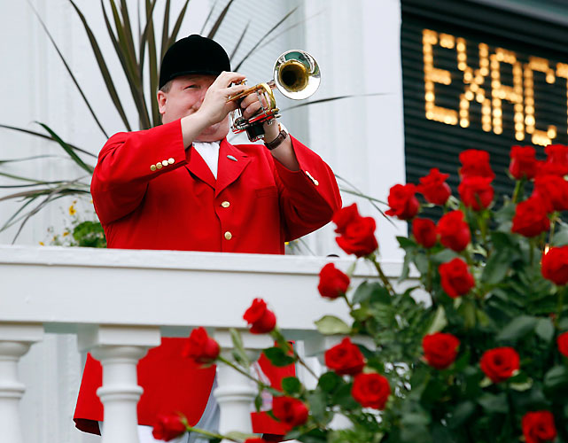 Steve Buttleman, the official bugler at Churchill Downs since 1995,  gets Derby day started.