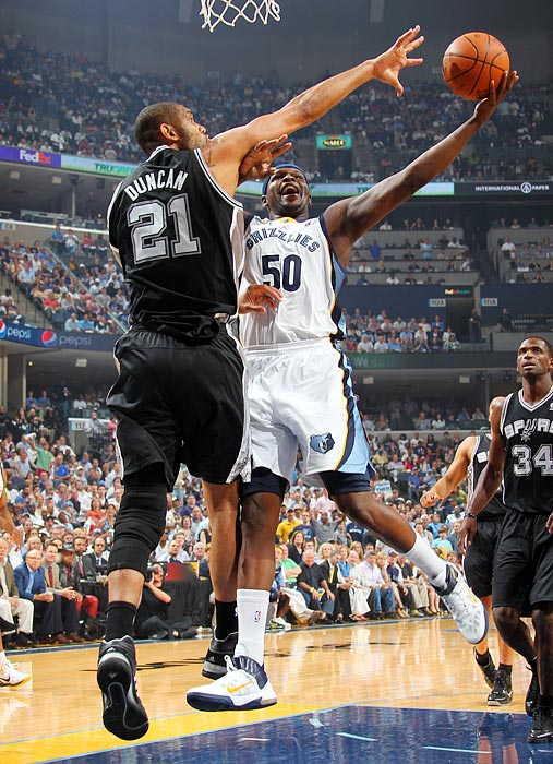 Memphis forward Zach Randolph (right) goes up against Spurs forward Tim Duncan during the Grizzlies' 99-91 upset victory over the Spurs in Game 6 of the Western Conference quarterfinals.