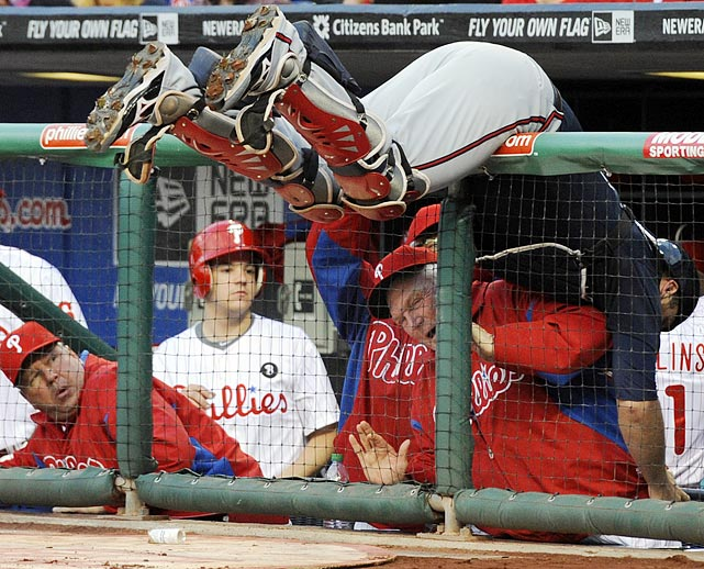 Oh, the perils of major league managing. Phillies manager Charlie Manuel bears the brunt of Braves catcher Brian McCann's fall over the dugout railing during the first inning of the Braves' 5-0 victory on May 6.