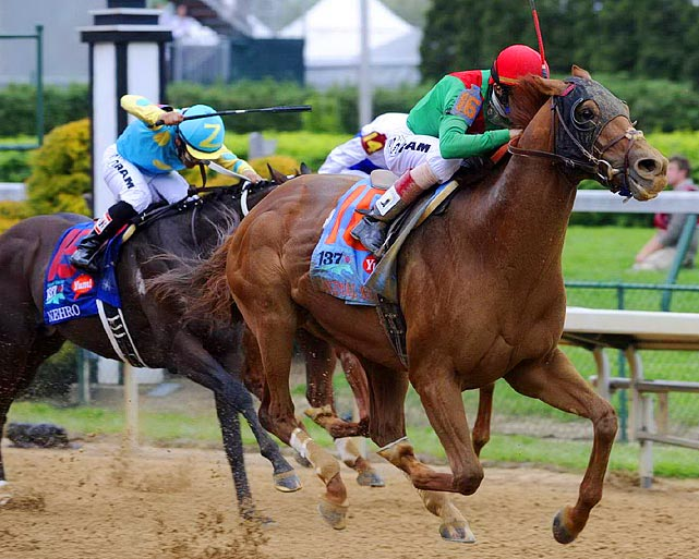 Jockey John Velazquez paced 20-1 long shot Animal Kingdom (right) to a victory in the Kentucky Derby, defeating Nehro (left) by 2 3/4 lengths.