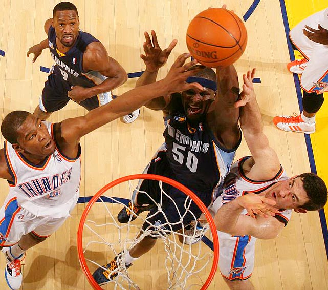 Oklahoma City Thunder forwards Kevin Durant (left) and Nick Collison (right) limited Grizzlies forward Zach Randolph (center) to 15 points on 2-of-13 shooting in the Thunder's 111-102 win in Game 2 of the Western Conference semifinals.