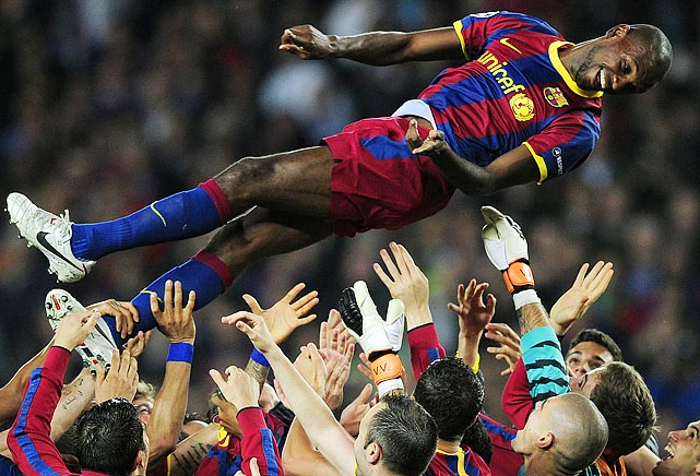 Barcelona players celebrated punching their ticket to the Champions League final by tossing teammate Eric Abidal in the air.  Barcelona qualified for the final after drawing 1-1 in the second leg of their semifinal clash with rivals Real Madrid.