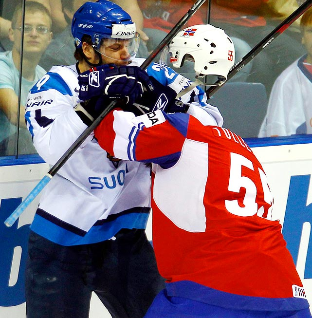 A pacifist by nature, Norway's Ole-Kristian Tollefsen (right) found an interesting way to avoid this skirmish with Finland's Petteri Nokelainen (left) during the quarterfinals of the hockey world championships.