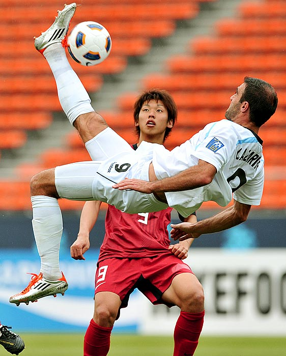 A Kashima Antlers player can only watch as Sydney FC's Bruno Cazarine (center) attempts a bicycle kick during the Kashima Antlers' 2-1 victory over Sydney FC in an Asian Champions League game.