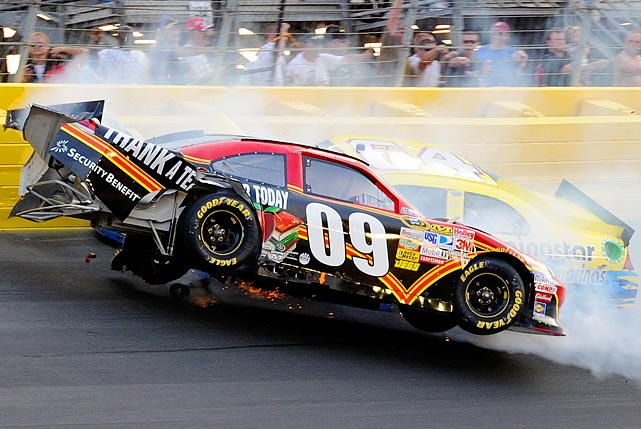 Derrike Cope, driver of the No. 64 Max Q Motorsports Ford, collides with Landon Cassill, driver of the No. 9 Thank A Teacher Today/Security Benefit Chevrolet, during the NASCAR Sprint Showdown at Charlotte Motor Speedway on May 21.
