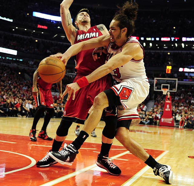 Chicago Bulls center Joakim Noah (right) attempts to pass around Miami Heat guard Mike Miller during the Heat's 85-75 victory in Game 2 of the Eastern Conference finals.