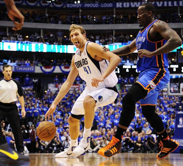 Just like Mike, Dirk Nowitzki (left) flashes a little tongue as he posts up Oklahoma City Thunder center Kendrick Perkins during the Thunder's 106-100 victory over the Mavericks in Game 2 of the Western Conference finals. Nowitzki would score 29 points in the losing effort.