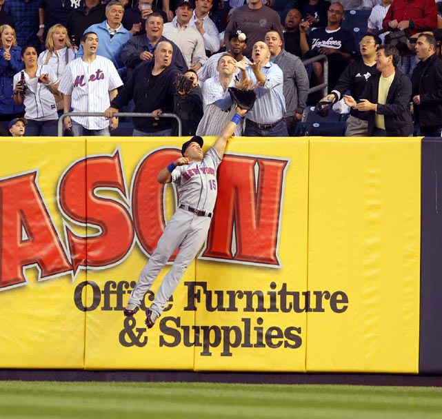 Mark Teixeira (not pictured) hits a home run over the outstretched glove of Carlos Beltran during the Mets' 2-1 victory over the Yankees on May 20.