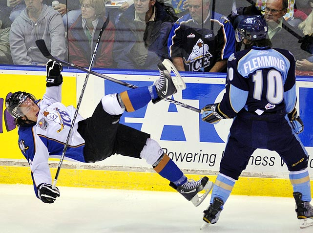 An apathetic crowd looks on as Kootenay Ice forward Jesse Ismond (left) goes down during the first period of the Ice's 3-1 loss to the Mississauga St. Michael's Majors in the semifinals of the Memorial Cup on May 27.