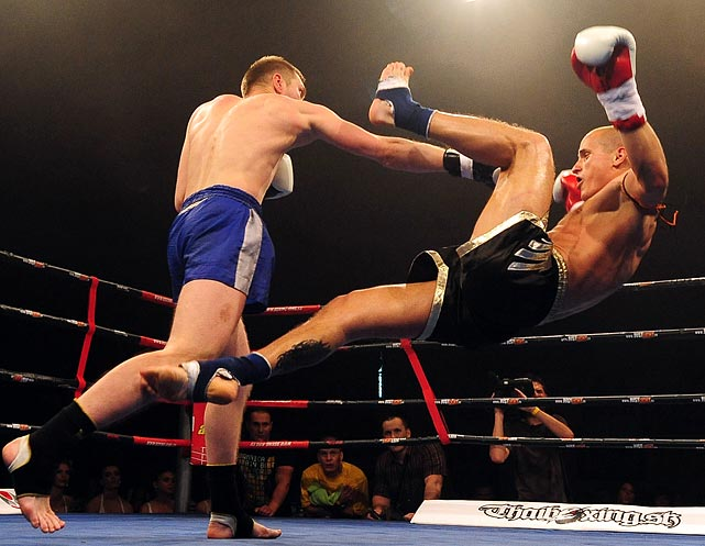 And down goes Rapcan! Slovakia's Michal Rapcan (right) falls to the ground following a punch from Pavel Yakimov during their muay thai match on May 28. Yakimov would go on to win by KO.