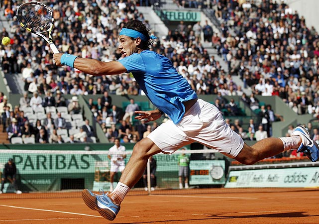 Rafael Nadal displays his trademark agility as he returns a ball from Pablo Andujar during the second round of the French Open on May 26. Nadal would go on to win 7-5, 6-3, 7-6.