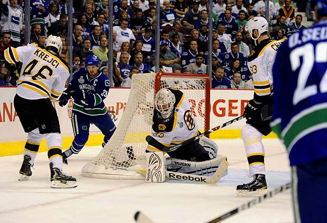 Thomas drew a virtual line in his crease throughout these crazy, contentious Stanley Cup finals, and Boston's brilliant goalie just wouldn't allow the Vancouver Canucks to cross it whenever it really mattered.  In Game 7, the 37-year-old netminder made 37 saves in the second shutout of his landmark finals performance, Patrice Bergeron and rookie Brad Marchand scored two goals apiece, and the Bruins beat the Canucks 4-0 to win their first NHL championship since 1972.