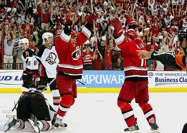 The first three games were decided by one goal. In Game 5, the Hurricanes rallied from a two-goal deficit and sent the match into OT where Cory Stillman scored to give them a 4-3 win and a three-games-to-two edge. But the gritty Sabres, who'd lost four regular defensemen and center Tim Connolly to injury, dug in and won Game 6 at home, 2-1 in OT, moving `Canes captain Rod Brind'Amour to address his team in the dressing room afterward. Game 7 then added to Buffalo's history of playoff heartbreak as the Hurricanes overcame a 2-1 deficit with Brind'Amour breaking a 2-2 tie by beating the Sabres' rookie netminder, Ryan Miller, at 11:22 of the third period. Carolina's rookie goalie, Cam Ward, made the lead stand up in a 4-2 victory that sent the `Canes to the final where they won their first Stanley Cup.