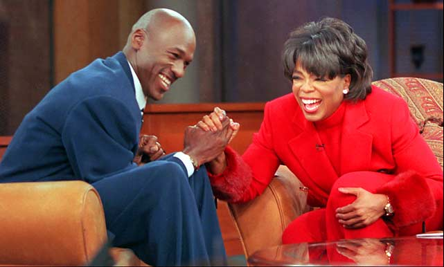 Michael Jordan and Oprah share a laugh during a November 1997 appearance.
