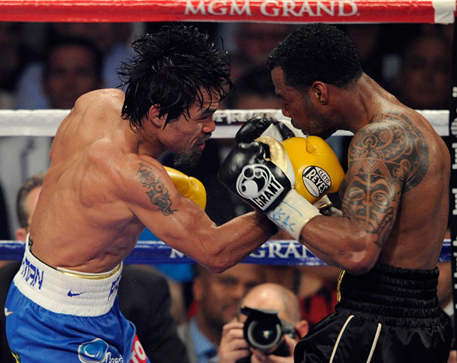 Pacquiao delivers a right to Mosley early in Saturday's fight.
