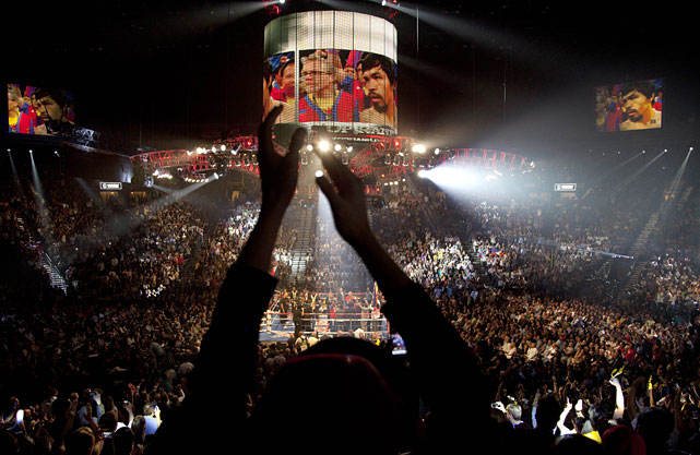 Fans cheer as Pacquiao is introduced before the start of Saturday's fight by ring announcer Jimmy Lennon Jr.