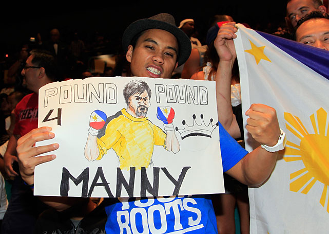 Francis Ramos, a fan of Manny Pacquiao, holds a sign at the weigh-in.