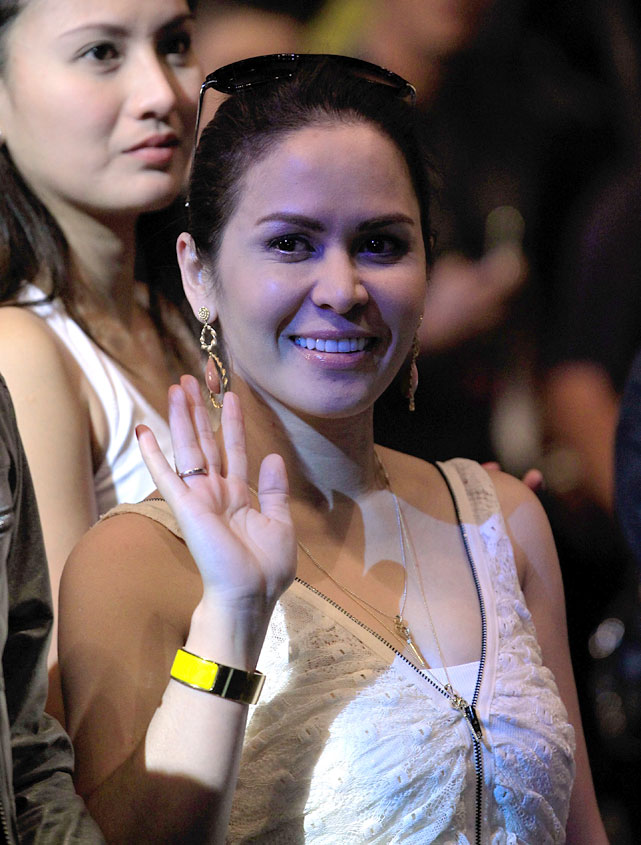 Manny Pacquiao's wife Jinkee waves to the crowd before watching her husband step on the scale.