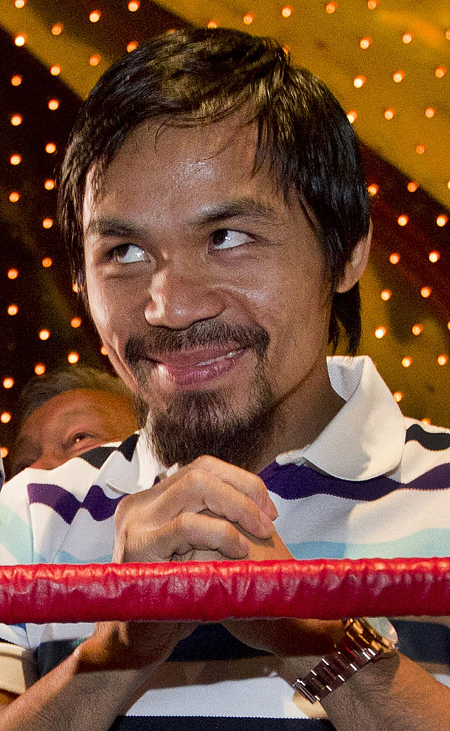 Manny Pacquiao acknowledges the crowd after arriving at the MGM Grand.