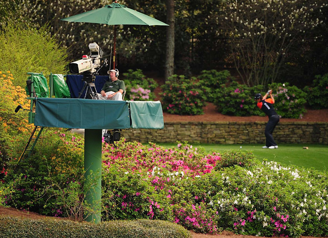 It's not always the fans who have trouble keeping their eyes open. In this photo, a TV cameraman appears to doze off as Justin Rose tees off on the 13th hole of the 2008 Masters.