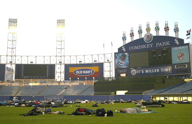 "Chicago White Sox fans camp out on the outfield grass of Comiskey Park during the ""White Sox Sleepover,"" a fundraising event put on by Chicago White Sox Charities."