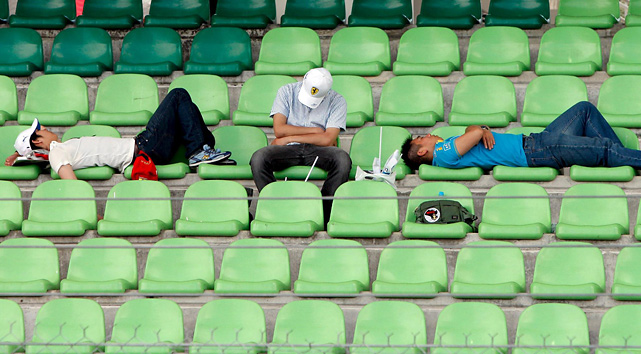 Racing fans nap in the stands during the Formula One Grand Prix of Malaysia.