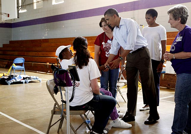 President Barack Obama speaks with residents at a school in Holt, Ala., two days after the tornado hit.
