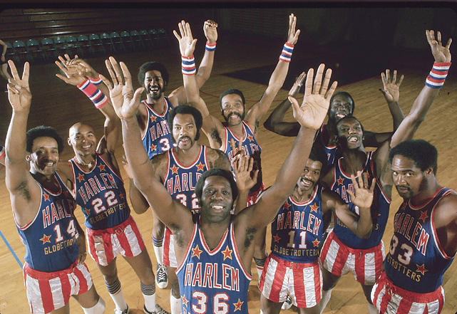 Meadowlark Lemon and the rest of the Globetrotters throw their hands up in the air while in Paris on a world tour.