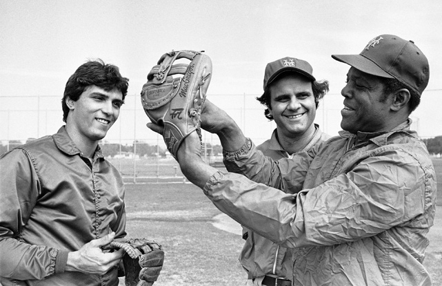 Mets outfielder Lee Mazzilli and manager Joe Torre listen to Mays talk about outfield defense in February 1978. The Mets brought in the 12-time Gold Glove winner to work on Mazzilli's defense and teach him the famed basket catch.