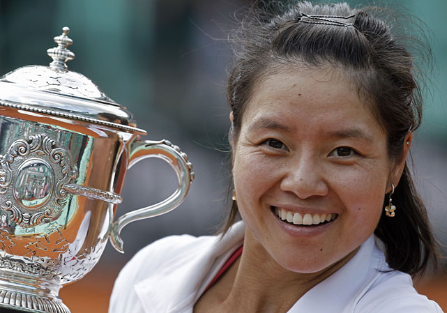 Li Na poses with the trophy after becoming the first Asian player to win the French Open -- or any Grand Slam tournament.