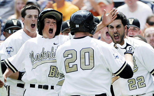 The Commodores, including Jason Esposito (22), greet Connor Harrell (20), after he hit a two-run homer in the sixth inning.