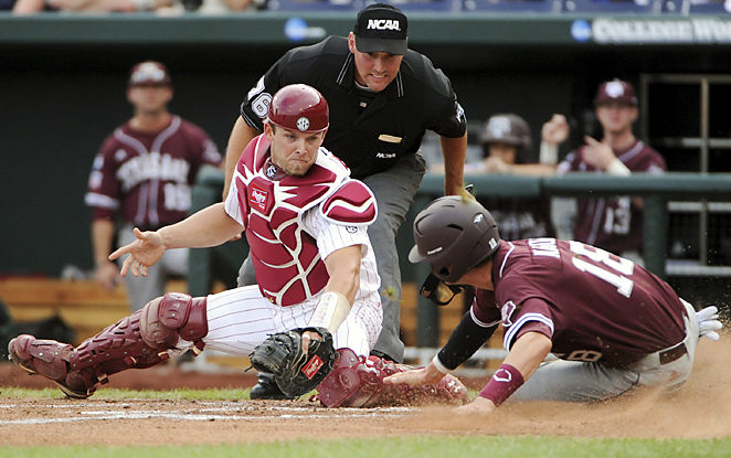 Texas A&M's Tyler Naquin (right) beats South Carolina's Robert Beary to the plate to score a first-inning run. The Aggies and Gamecocks were tied 4-4 after one inning.