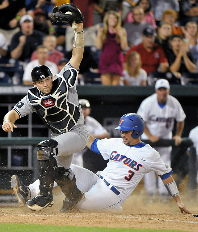 But South Carolina catcher Robert Beary saved the Gamecocks. The Gators loaded the bases in the bottom of the ninth in a 1-1 game, only to ground into two forceouts at home. The first (pictured) on a fine scoop and the second turned for an inning-ending double play.