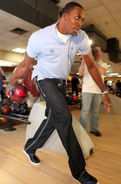 Dwight Howard held a bowling-themed fundraiser for his charity organization, the D12 Foundation, in Orlando on Saturday. Howard isn't the first athlete to try to avoid the gutter. Here is a collection of athletes at the bowling alley.