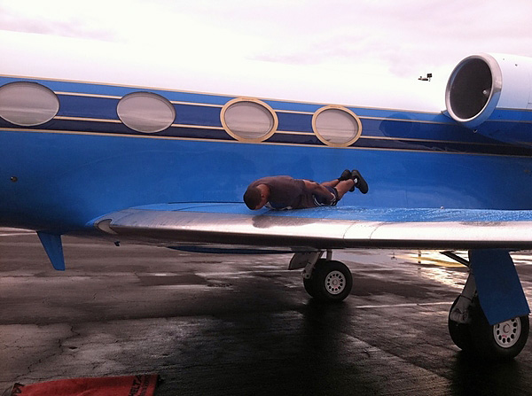The motorcycle, the Rolls Royces, the Porsche and the limo could still be topped: Dwight Howard planked his own plane.