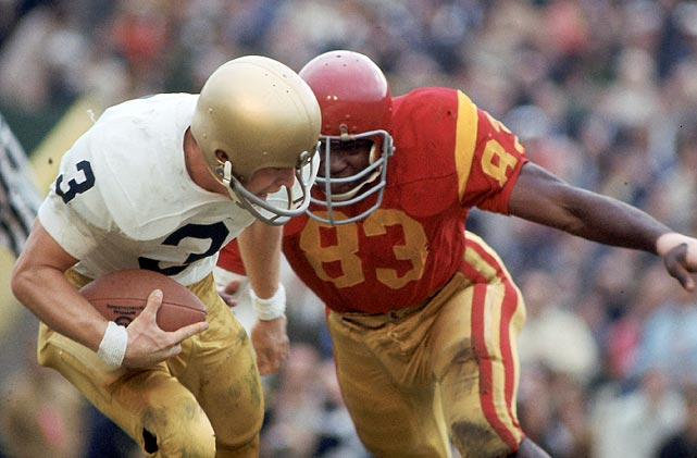 USC rode its rowdy defense to the 1970 Rose Bowl victory. In its regular season finale, the Wild Bunch intercepted UCLA quarterback Dennis Dummit five times and knocked him to the ground at least 12 more in a 14-12 win. The front five of Al Cowlings, Bubba Scott, Charlie Weaver, Jimmy Gunn and Tody Smith attacked the pocket with regularity, pounding quarterbacks along the way. The aggressive defense continued in a 10-3 victory over Michigan in the Rose Bowl.