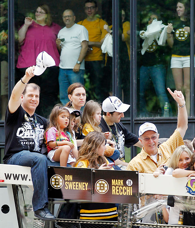 Mark Recchi (far left) and his family acknowledge the fans. Recchi, the oldest active NHL player at 43, went out on top, retiring after winning the Cup.