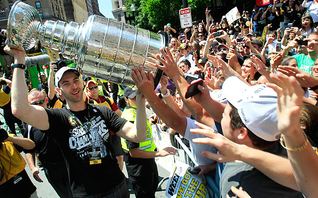 Chara allows front-row fans to touch the most famous trophy in team sports.