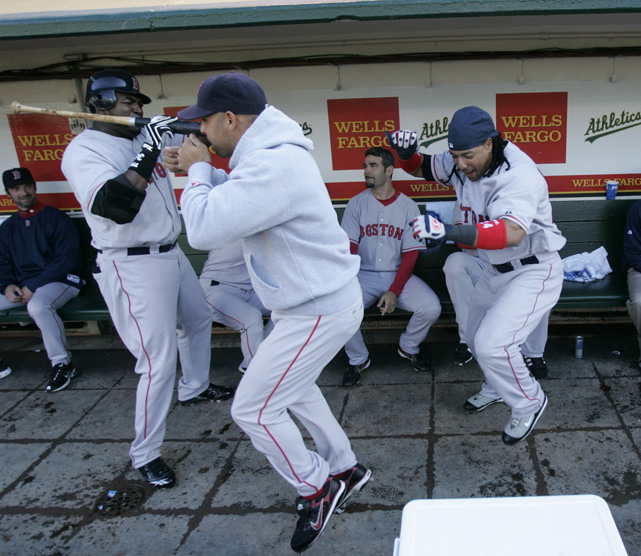 David Ortiz, Alex Cora and Manny Ramirez bust a move inside the dugout.