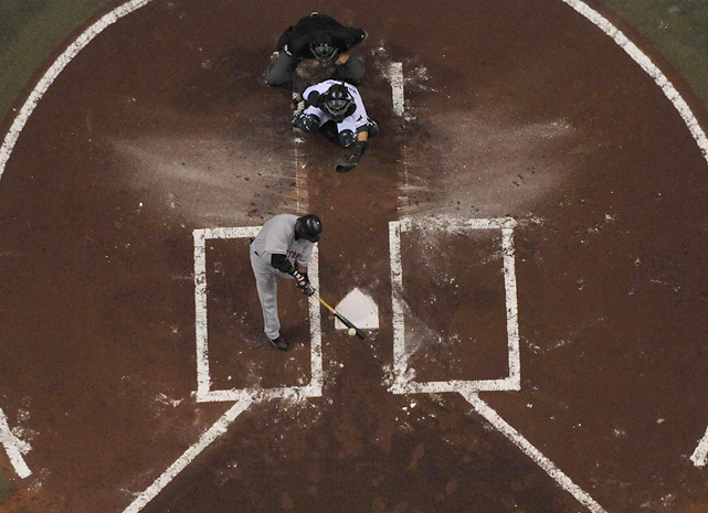 Big Papi crushes a pitch at Tropicana Field in a picture taken from one of the heavily criticized catwalks.