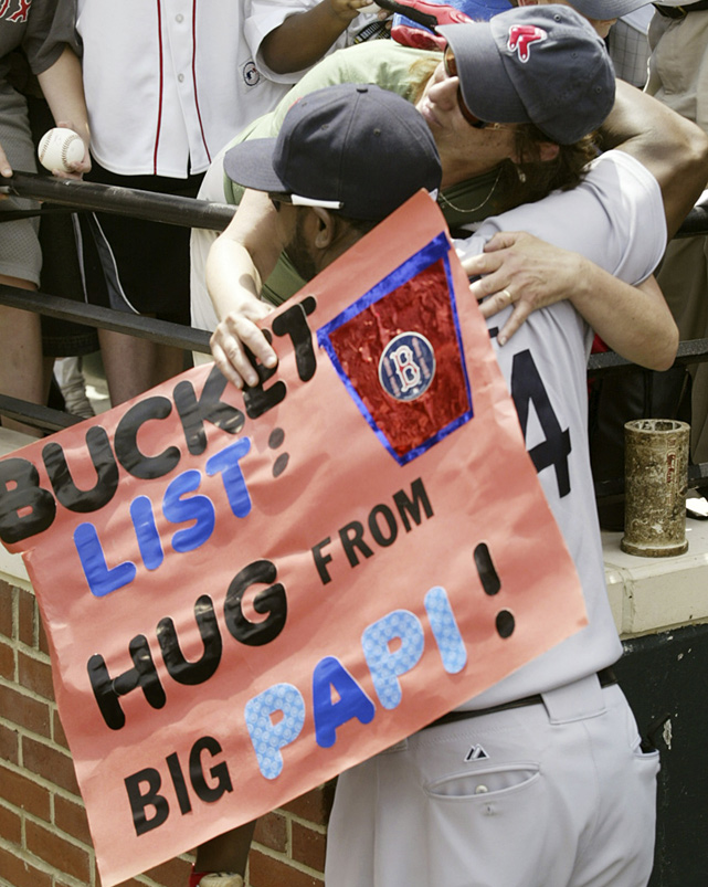 A Red Sox fan gets her wish as Big Papi gives her a hug.