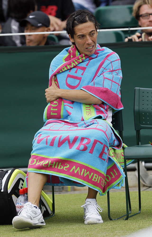Italy's Francesca Schiavone sits on her chair between games during her third-round match against Austria's Tamira Paszek.