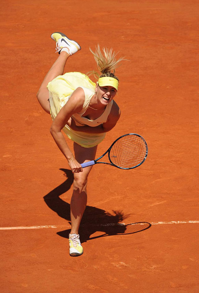 Maria Sharapova serves to Andrea Petkovic during their quarterfinal match. Sharapova won 6-0, 6-3 to advance to her first Grand Slam semifinal in more than three years.